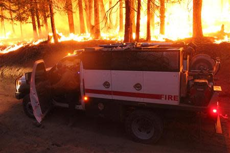 A firefighter and his pump rig stops at the Rim Fire at night in this undated United States Forest Service handout photo near Yosemite National Park, California, released to Reuters August 30, 2013. Fire crews battling to outflank a monster wildfire inside Yosemite National Park made headway on Friday in confining flames to wilderness areas but were powerless to salvage the region's sputtering tourist economy at the end of its peak summer tourist season. REUTERS/Mike McMillan/U.S. Forest Service/Handout via Reuters