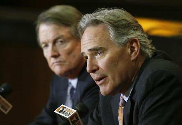 University of Texas athletic director Steve Patterson, right, and school president Bill Powers discuss a search for a new head football coach in Austin, Texas, on Sunday, Dec. 15, 2013. Current coach Mack Brown announced he was stepping down from the position following the Valero Alamo Bowl on Dec. 30. (AP Photo/Jack Plunkett)