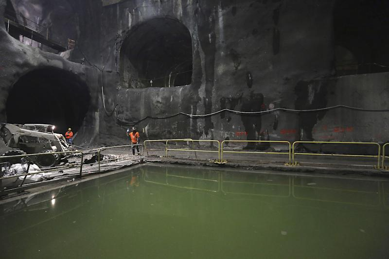 In this Tuesday, Jan. 29, 2013 photo, contractors work on the East Side Access project beneath midtown Manhattan, in New York. The East Side Access is one of three bold projects under New York that will expand what's already the nation's biggest mass-transit system by 2019. (AP Photo/Mary Altaffer)