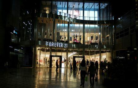 People walk next to Forever 21 store at Jockey Plaza Mall in Lima