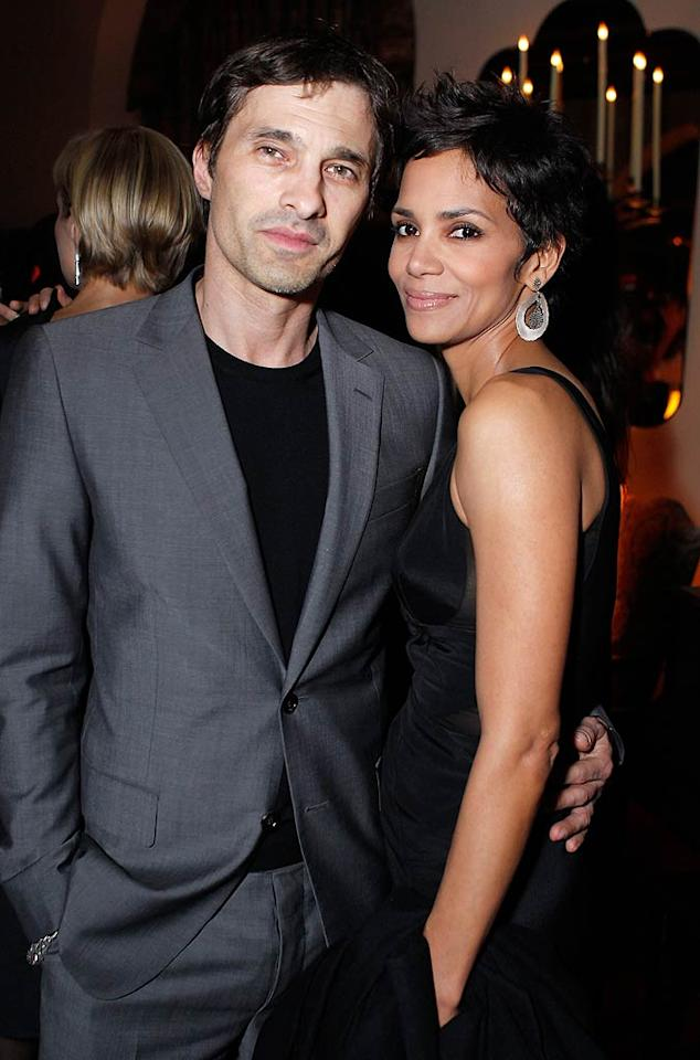 "After flaunting her curves in a stunning red Elie Saab gown the previous night, for this intimate dinner Halle Berry opted to wear a low-key LBD and the best arm candy a girl could have -- her hot boyfriend Olivier Martinez. Jeff Vespa/<a href=""http://www.wireimage.com"" target=""new"">WireImage.com</a> - February 23, 2011"