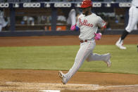 Philadelphia Phillies' Odubel Herrera scores on a sacrifice fly ball hit by Matt Joyce during the fourth inning of a baseball game against the Miami Marlins, Thursday, May 27, 2021, in Miami. (AP Photo/Wilfredo Lee)