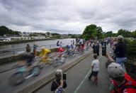 The pack with Netherland's Mathieu Van Der Poel, wearing the overall leader's yellow jersey, rides during the third stage of the Tour de France cycling race over 182.9 kilometers (113.65 miles) with start in Lorient and finish in Pontivy, France, Monday, June 28, 2021. (AP Photo/Daniel Cole)