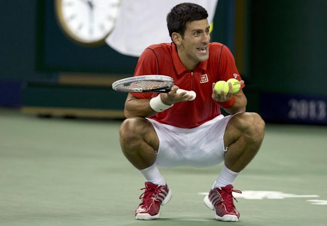 Serbia's Novak Djokovic protests during the singles semifinal match against France's Jo-Wilfried Tsonga at the Shanghai Masters tennis tournament at the Qizhong Forest Sports City Tennis Center in Shanghai, China on Saturday, Oct. 12, 2013. Djokovic won 6-2, 7-5. (AP Photo/Ng Han Guan)