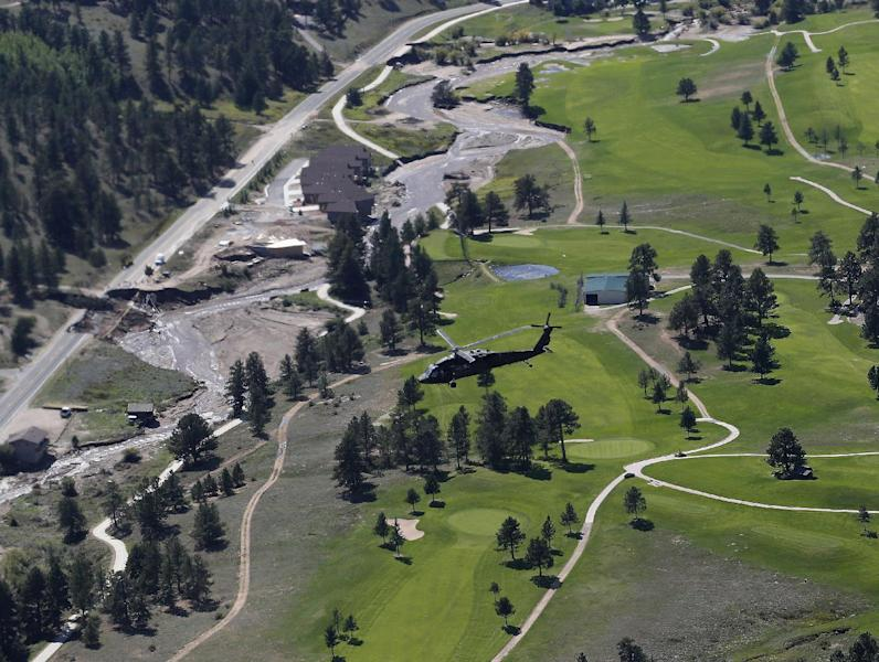 A Blackhawk helicopter with Vice President Biden aboard, inspects flood damage near Estes Park, Colo., Monday, Sept. 23, 2013. Biden took a helicopter tour of flood damage and to survey recovery efforts. (AP Photo/Ed Andrieski)