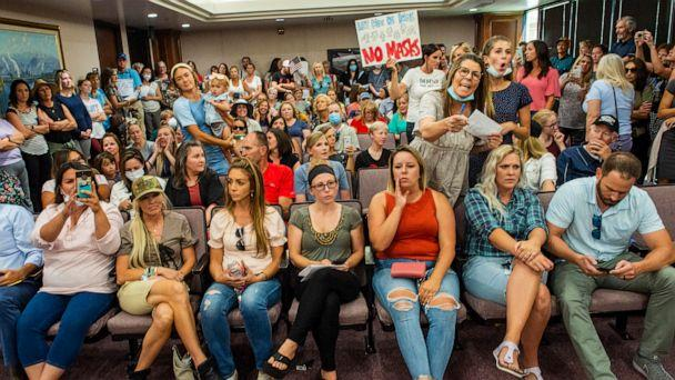 PHOTO: Angry residents react when the Utah County Commission meeting was adjourned before it even started, July 15, 2020, in Provo, Utah. (Rick Egan/AP)