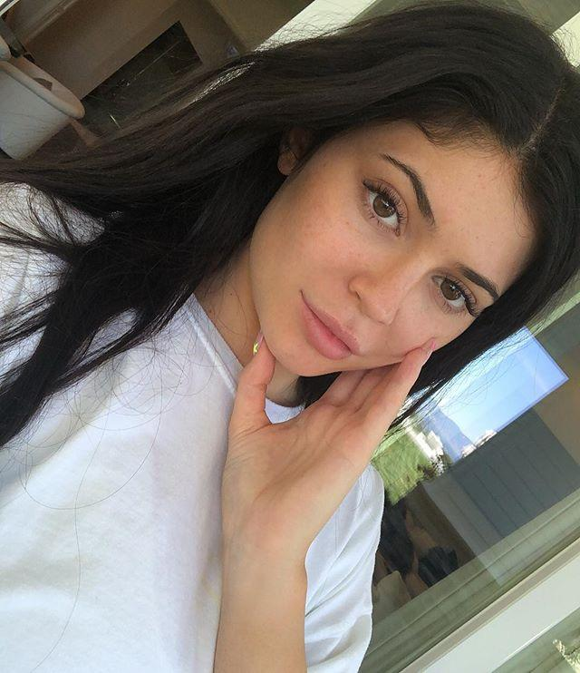 """<p>Kay, so this was when Kylie was busy promoting her new, <a href=""""https://www.cosmopolitan.com/style-beauty/beauty/a27471420/kylie-jenner-walnut-face-scrub-bad-for-skin-twitter-reactions/"""" target=""""_blank"""">massively trolled</a> skincare line. I'm not entirely convinced she's fully makeup-free here (like, hi, my brows don't look like that when I wake up in the morning!), but judging from those visible freckles, she's definitely not wearing any foundation. Cute. </p><p><a href=""""https://www.instagram.com/p/BwXsKzrn015/?utm_source=ig_embed"""">See the original post on Instagram</a></p>"""