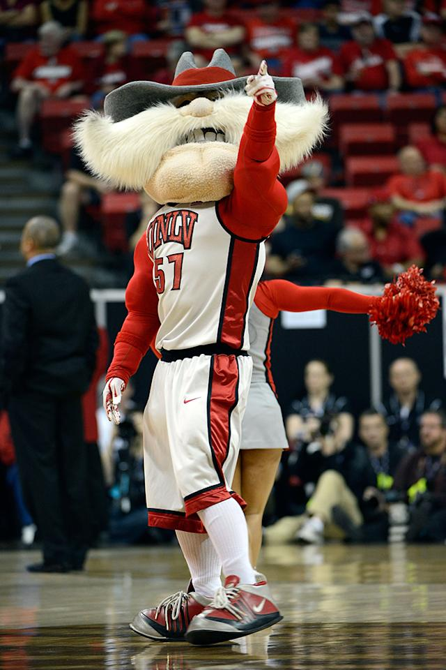 UNLV Rebels mascot Hey Reb appears on court during a quarterfinal game of the Reese's Mountain West Conference Basketball tournament against the Air Force Falcons at the Thomas & Mack Center on March 13, 2013 in Las Vegas, Nevada. UNLV won 72-56.  (Photo by Jeff Bottari/Getty Images)