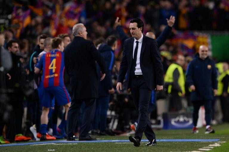 Paris Saint-Germain's head coach Unai Emery (R), seen on the sideline during their UEFA Champions League round of 16 2nd leg match against Barcelona, at Camp Nou stadium in Barcelona, on March 8, 2017