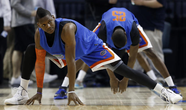 Florida forward Will Yeguete (15) works out during practice at the NCAA college basketball tournament, Wednesday, March 26, 2014, in Memphis, Tenn. Florida plays UCLA in a regional semifinal on Thursday. (AP Photo/John Bazemore)