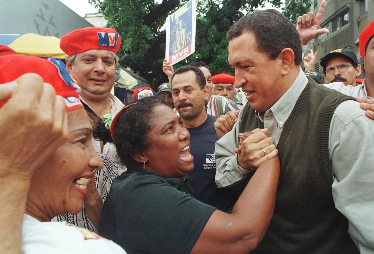 Former coup leader and presidential candidate Hugo Chavez greets supporters in Caracas, Venezuela, in May 16, 1998 photo. (AP Photo/Jose Caruci)