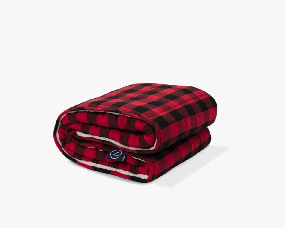 """<p><strong>Gravity Blankets</strong></p><p>Gravity Blankets</p><p><a href=""""https://go.redirectingat.com?id=74968X1596630&url=https%3A%2F%2Fgravityblankets.com%2Fcollections%2Fweighted-blankets-throws%2Fproducts%2Fz-by-gravity-weighted-throw%3Fvariant%3D32572653830218&sref=https%3A%2F%2Fwww.goodhousekeeping.com%2Fhome-products%2Fg35685540%2Fgravity-blankets-weighted-blanket-sale%2F"""" rel=""""nofollow noopener"""" target=""""_blank"""" data-ylk=""""slk:Shop Now"""" class=""""link rapid-noclick-resp"""">Shop Now</a></p><p><strong><del>$79.99</del> $67.99 (15% off)</strong></p><p>Found: The perfect, soothing layer for your next movie marathon.</p>"""