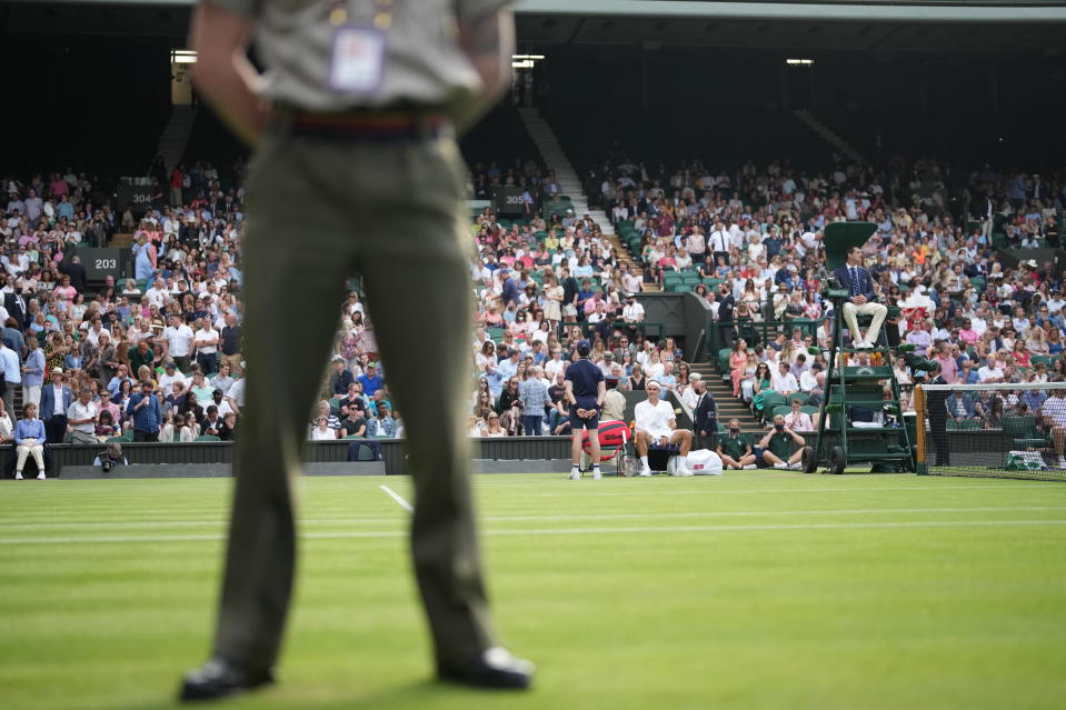 Switzerland's Roger Federer sits in his chair during the men's singles second round match against Richard Gasquet of France on day four of the Wimbledon Tennis Championships in London, Thursday July 1, 2021. (AP Photo/Alberto Pezzali)