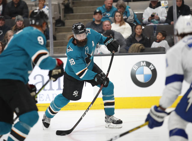 San Jose Sharks defenseman Brent Burns (88) shoots the puck during the first period of the team's NHL hockey game against the Tampa Bay Lightning in San Jose, Calif., Saturday, Feb. 1, 2020. (AP Photo/Josie Lepe)
