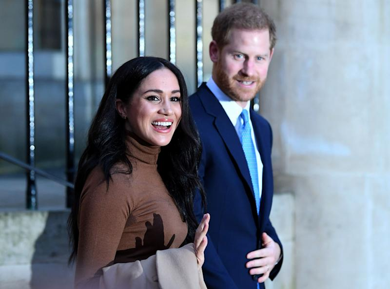 Britain's Prince Harry, Duke of Sussex and Meghan, Duchess of Sussex reacts as they leave after her visit to Canada House.