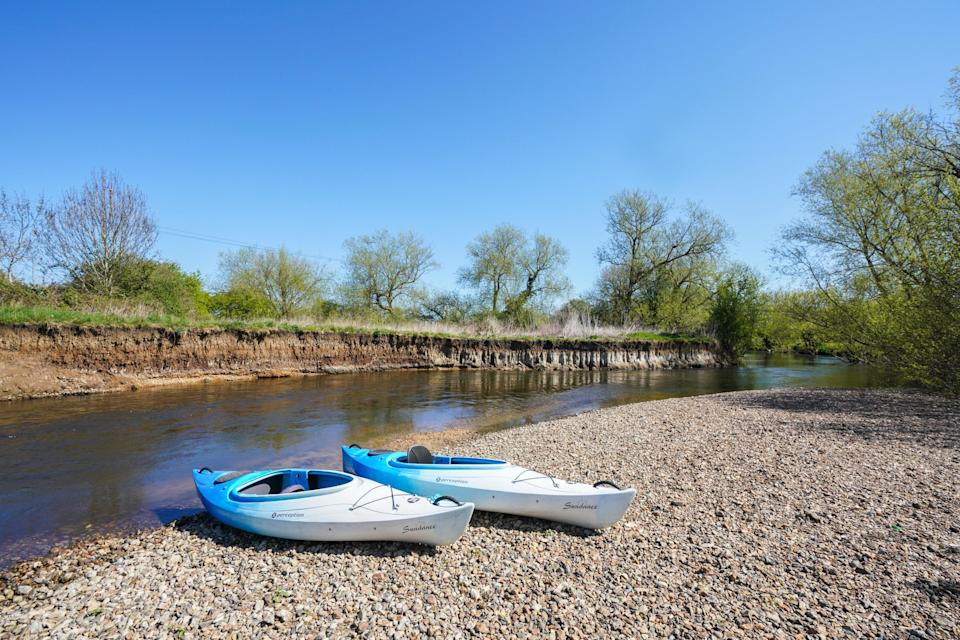 <p>Island House, the only property to have car access on Wheatleys Eyot, is for sale</p> (Knight Frank)