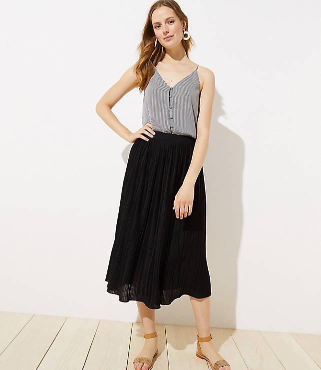 young woman in a pleated skirt