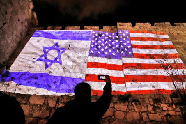 <p>A giant U.S. flag screened alongside Israel's national flag by the Jerusalem municipality on the walls of the Old City. (Photo: Ahmad Gharabli/AFP/Getty Images) </p>