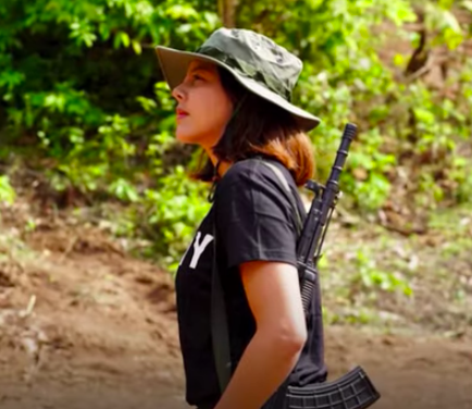 <p>The 32-year-old former beauty queen, Htar Htet Htet, says she is undergoing arms training in a jungle and is prepared to give up everything</p> (Yonhap News/Screengrab)