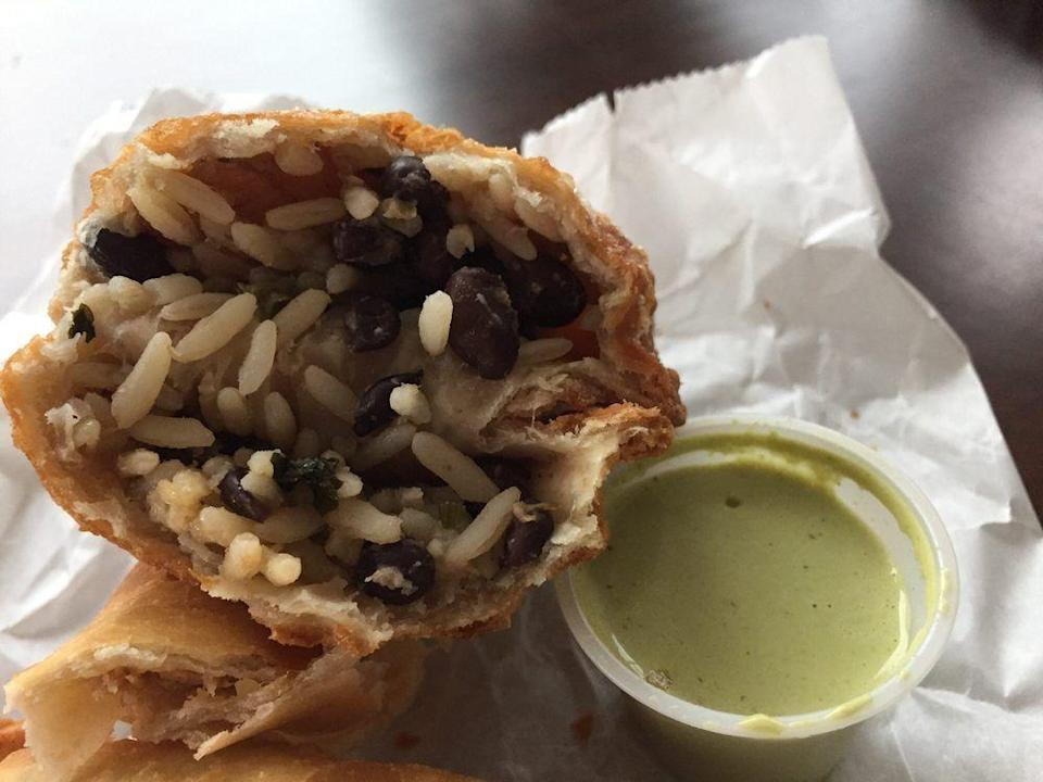 """<p><strong><a href=""""https://www.yelp.com/biz/caracas-empanadas-madison-2"""" rel=""""nofollow noopener"""" target=""""_blank"""" data-ylk=""""slk:Caracas Empanadas"""" class=""""link rapid-noclick-resp"""">Caracas Empanadas</a>, Madison</strong><strong><br></strong></p><p>""""Yes, the hype is real. These empanadas were soooo good and soooo fresh! And please, get the green sauce."""" – Yelp user <a href=""""https://www.yelp.com/user_details?userid=Jfw3uMuOH1XdJpeC_1PMKw"""" rel=""""nofollow noopener"""" target=""""_blank"""" data-ylk=""""slk:Amanda B."""" class=""""link rapid-noclick-resp"""">Amanda B.</a></p><p>Photo: Yelp/<a href=""""https://www.yelp.com/user_details?userid=wd3xoNaDLib8dhQ7BxUl6g"""" rel=""""nofollow noopener"""" target=""""_blank"""" data-ylk=""""slk:Stacey L."""" class=""""link rapid-noclick-resp"""">Stacey L.</a></p>"""