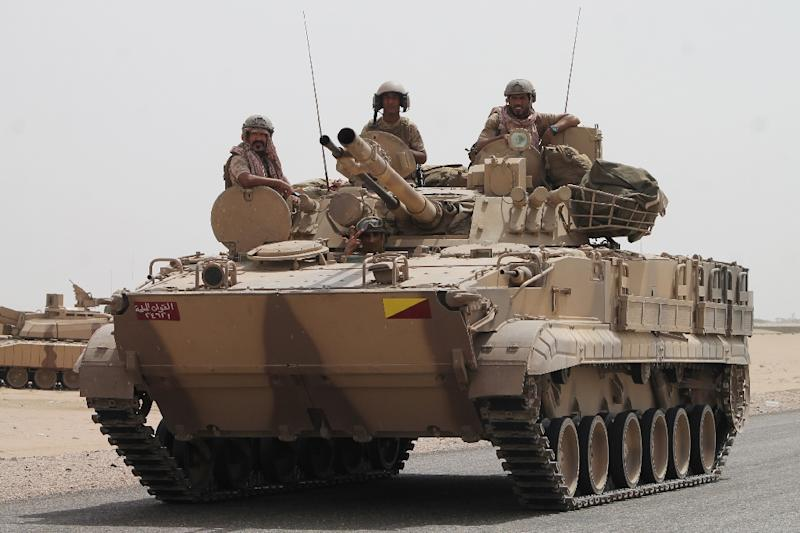 Soldiers stand on a tank of the Saudi-led coalition deployed on the outskirts of the southern Yemeni port city of Aden on August 3, 2015