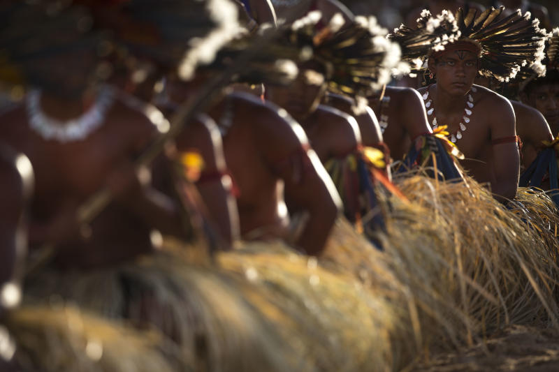 "Bororo Indians perform a traditional ritual during the 12th Indigenous Games in Cuiaba, Brazil, Thursday, Nov. 14, 2013. More than 1,500 participants from 48 Brazilian tribes, as well as from more than a dozen other nations, descended this week on Cuiaba, the capital of Mato Grosso state, for the games that end Saturday. All participants will earn ""medals"" carved from wood, seeds and other natural items. (AP Photo/Felipe Dana)"