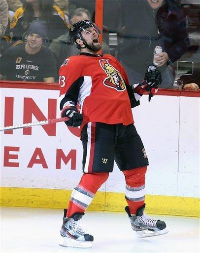 Ottawa Senators Guillaume Latendresse (73) celebrates his first goal during against the Boston Bruins during the first period of an NHL hockey game against the Ottawa Senators on Monday, March 11, 2013, in Ottawa, Ontario. (AP Photo/The Canadian Press, Fred Chartrand)