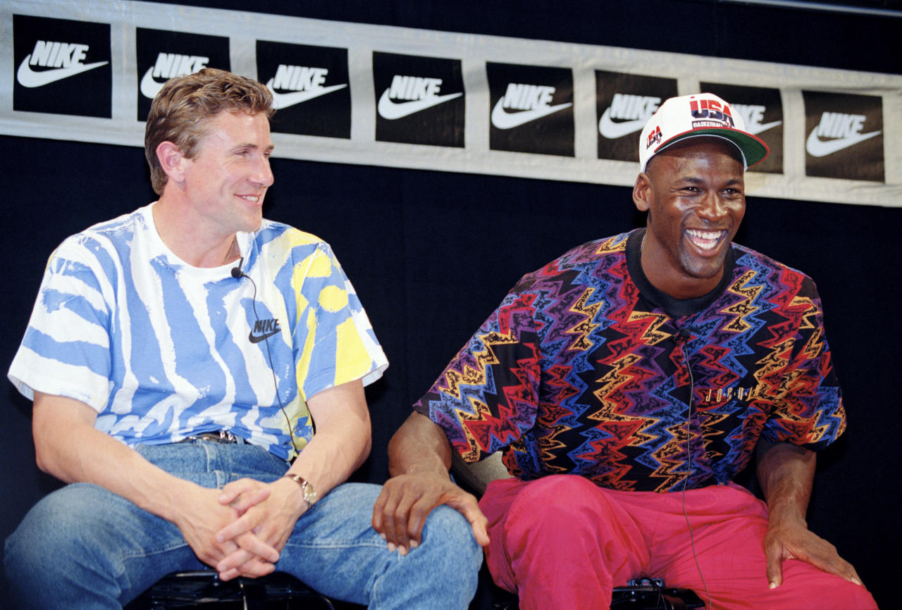 Michael Jordan, right, sits with Ukrainian track and field athlete Sergey Bubka, during a news conference for Nike in Barcelona, Spain, on July 25, 1992. (AP Photo/Eric Risberg)