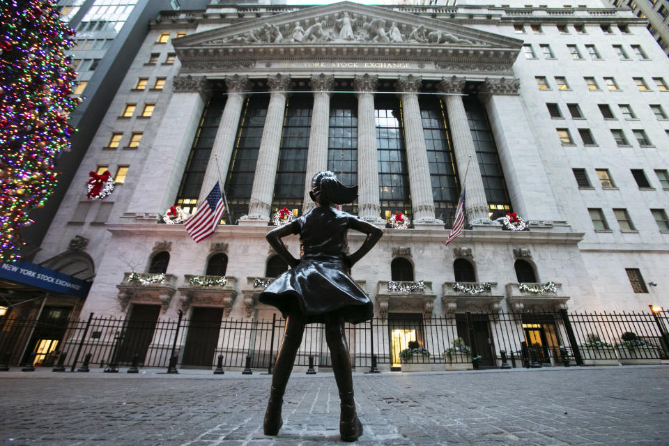 The Fearless Girl statue stands at its new location in front of the New York Stock Exchange, Tuesday, Dec. 11, 2018. (AP Photo/Mark Lennihan)