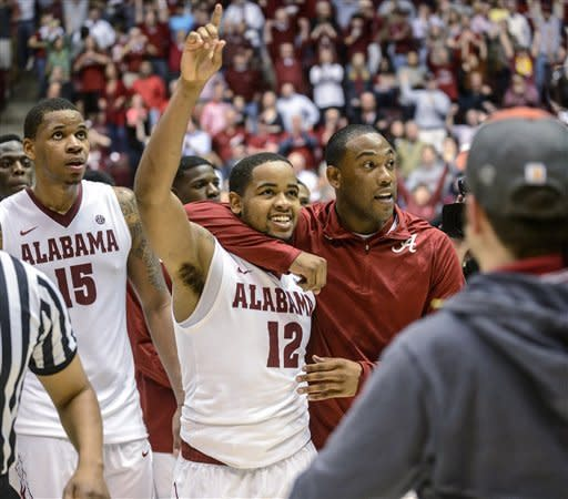 Alabama guard Andrew Steele, right, hugs guard Trevor Releford (12) after Releford hit the game-winning buzzer-beater from 50 feet against Georgia during an NCAA college basketball game Saturday, March 9, 2013, in Tuscaloosa, Ala. Alabama won 61-58. (AP Photo/AL.com, Vasha Hunt)