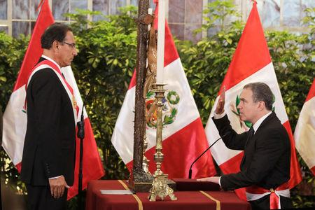 Peru's President Martin Vizcarra and new Prime Minister Salvador del Solar attend a swearing-in ceremony at the government palace in Lima, Peru March 11, 2019. REUTERS/Guadalupe Pardo