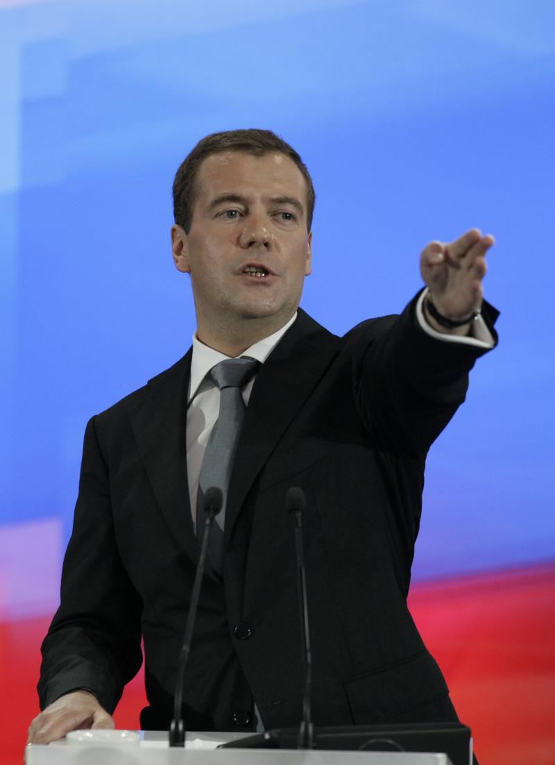 Russian President Dmitry Medvedev calls for a question during his news conference at a business school in Skolkovo, outside Moscow, Russia, on Wednesday, May 18, 2011. Russia's President Dmitry Medvedev remained coy Wednesday about seeking a second term, but he sought to project an image of a strong and modern leader with tough statements on foreign policy and promises of domestic modernization. (AP Photo/Ivan Sekretarev)