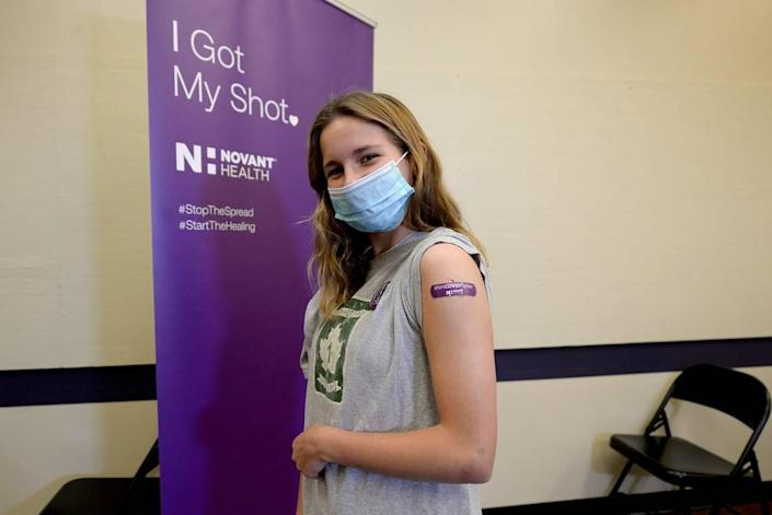 Cassidy Black, 13 years, was the first teenager to receive a COVID vaccination shot on Wednesday, May 12, 2021 at the Novant Health clinic at 6070 East Independence Blvd.