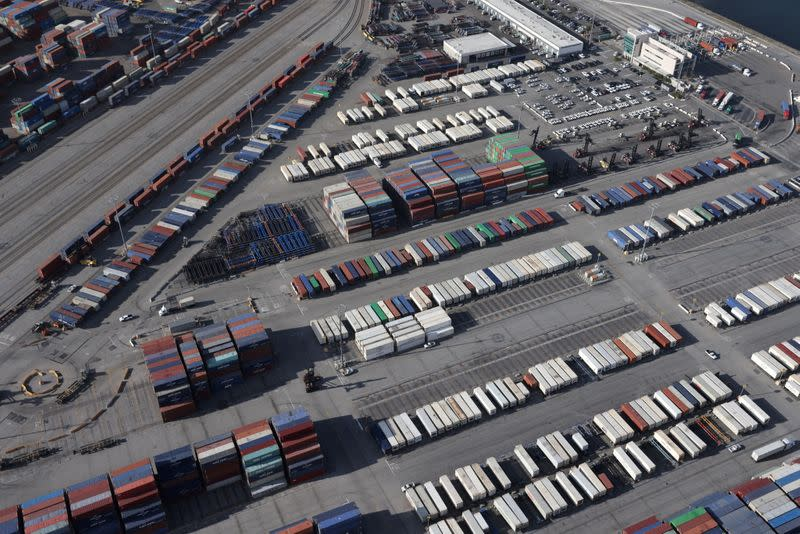 FILE PHOTO: Shipping containers sit on the dock at a container terminal at the Port of Long Beach-Port of Los Angeles complex, amid the coronavirus disease (COVID-19) pandemic, in Los Angeles