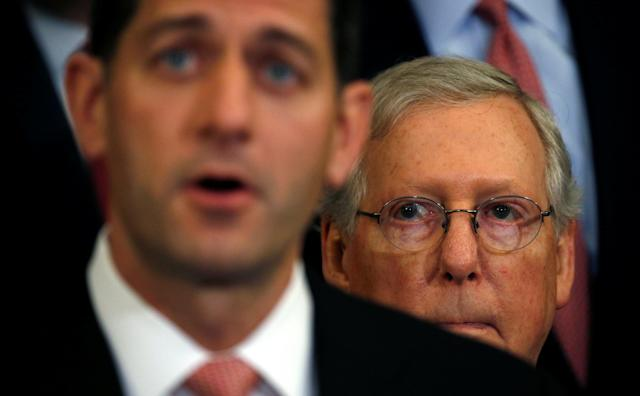 U.S. Senate Majority Leader Mitch McConnell (R) listens to Speaker of the House Paul Ryan (L) speak about the Republican tax plan in the U.S. Capitol in Washington, U.S., September 27, 2017. REUTERS/Kevin Lamarque