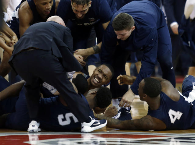 Penn State guard Tony Carr, center, celebrates with teammates after his winning basket against Ohio State. (AP Photo/Paul Vernon)