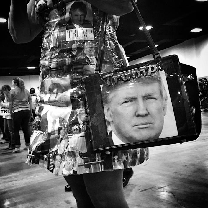 <p>A woman wears a dress and carries a purse featuring photos of Donald Trump at the candidate's rally on Feb. 26 in Fort Worth, Texas. (Photo: Holly Bailey/Yahoo News) </p>