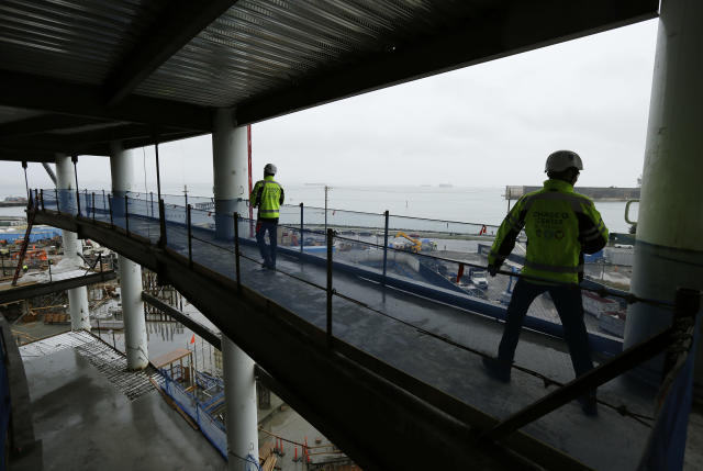 In this photo taken Jan. 24, 2018, Golden State Warriors President and COO Rick Welts, right, looks out at views of San Francisco Bay during a tour of Chase Center under construction in San Francisco. The Warriors COO has been entrusted by owners Joe Lacob and Peter Guber to be the unofficial foreman as Chase Center goes up in the Mission Bay district of San Francisco for a scheduled opening of late summer 2019. (AP Photo/Eric Risberg)