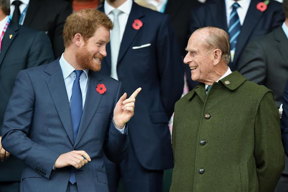 <p>Like grandad like grandson: Harry and Philip shared a cheeky moment at the 2015 Rugby World Cup Final match. Photo: Getty Images.</p>