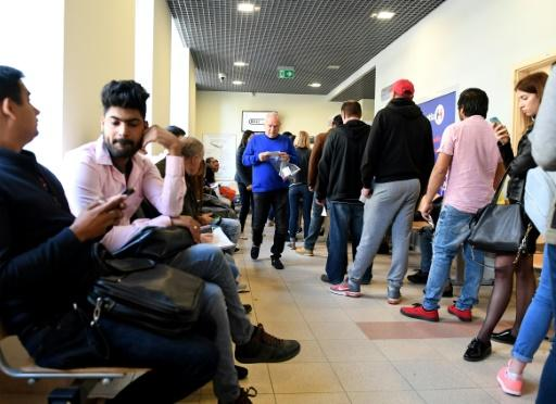 There are long lines to get work papers in Poland even though the nation needs foreign workers to fill jobs