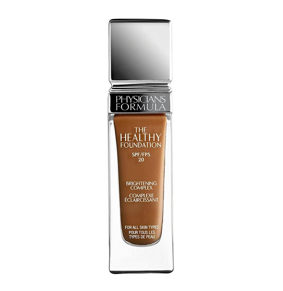 "<p>""I've used a ton of different foundations, but the one I've found myself liking the most recently is this <a href=""https://www.popsugar.com/buy/Physicians-Formula-Healthy-Foundation-SPF-20-587549?p_name=Physicians%20Formula%20The%20Healthy%20Foundation%20with%20SPF%2020&retailer=amazon.com&pid=587549&price=13&evar1=bella%3Auk&evar9=40920323&evar98=https%3A%2F%2Fwww.popsugar.com%2Fbeauty%2Fphoto-gallery%2F40920323%2Fimage%2F47601978%2FPhysicians-Formula-Healthy-Foundation-with-SPF-20&list1=makeup%2Cbeauty%20products%2Ceditors%20pick%2Cbeauty%20shopping%2Cbeauty%20news%2Cdrugstore%20beauty%2Cskin%20care&prop13=api&pdata=1"" class=""link rapid-noclick-resp"" rel=""nofollow noopener"" target=""_blank"" data-ylk=""slk:Physicians Formula The Healthy Foundation with SPF 20"">Physicians Formula The Healthy Foundation with SPF 20</a> ($13). It's not too thick when I apply it and it helps to make my skin look so much smoother when I wear it throughout the day, not to mention how I don't feel oily or weighed down when I have it on."" - DJ</p>"