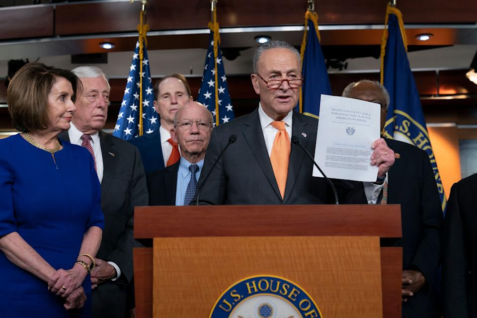 Speaker of the House Nancy Pelosi, D-Calif., left, Senate Minority Leader Chuck Schumer, D-N.Y., center, and other congressional leaders, react to a failed meeting with President Donald Trump at the White House on infrastructure, at the Capitol in Washington, Wednesday, May 22, 2019. From left are Pelosi, House Majority Leader Steny Hoyer, D-Md., Sen. Ron Wyden, D-Ore., House Transportation and Infrastructure Committee Chair Peter DeFazio, D-Ore., and Sen. Schumer. (AP Photo/J. Scott Applewhite)