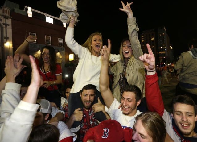 Boston Red Sox fans celebrate following Game 6 of baseball's World Series between the Red Sox and St. Louis Cardinals Wednesday, Oct. 30, 2013, in Boston. The Red Sox won 6-1 to win the series. (AP Photo/Steven Senne)