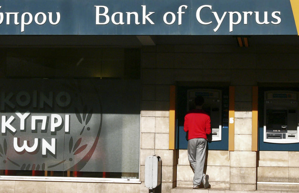 <p> FILE - In this Oct. 30, 2013, file photo. a man uses an ATM machine outside of a branch of Bank of Cyprus in capital Nicosia, Cyprus. U.S. Treasury Department agents have recently obtained information about offshore financial transactions involving President Donald Trump's former campaign chairman, Paul Manafort, as part of a federal anti-corruption probe into his work in Eastern Europe, The Associated Press has learned. Information about Manafort's banking transactions was turned over to U.S. agents working in the Financial Crimes Enforcement Network, a Treasury Department bureau, by the Unit for Combating Money Laundering in the Mediterranean country of Cyprus, a person familiar with the case said, speaking on condition of anonymity because the person was not authorized to publicly discuss an ongoing, global criminal investigation. (AP Photo/Petros Karadjias, File) </p>
