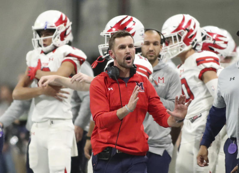 In this Dec. 12, 2018 photo, Milton coach Adam Clack reacts on the sideline during the first half against Colquitt County during the Class 7A high school football championship at Mercedes-Benz Stadium in Atlanta. Georgia has become the clear No. 4 state behind Texas, Florida and California for producing major college football players. (Jason Getz/Atlanta Journal-Constitution via AP)