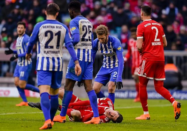 Agony: Robert Lewandowski feels the pain as Bayern Munich are held 0-0 by Hertha Berlin (AFP Photo/Guenter SCHIFFMANN)