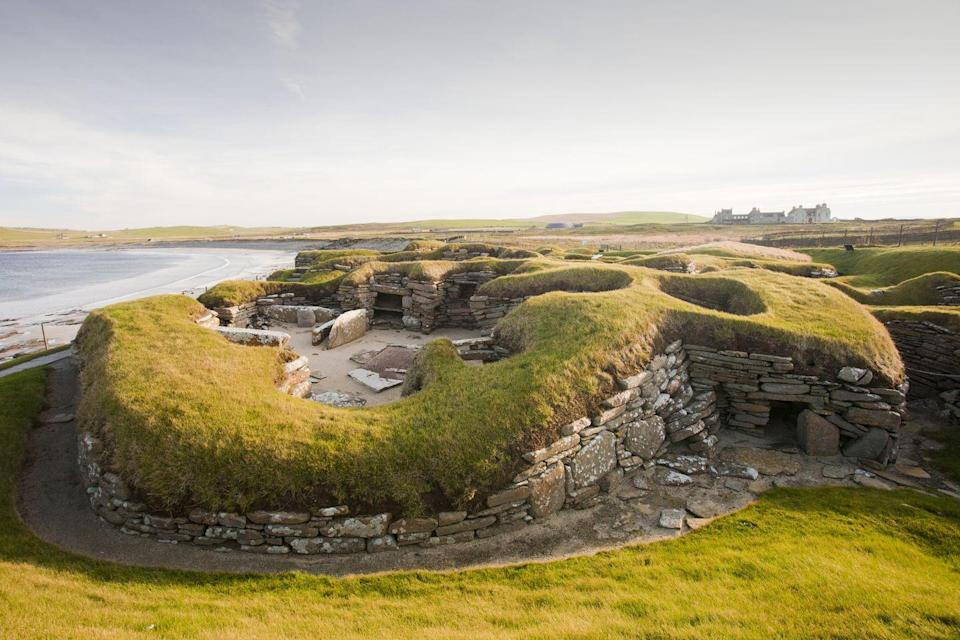 """<p>We've all heard of Orkney crab. Well, there's nowhere you can have it fresher than here, in a restaurant on the craggy cliffs of Orkney's<a href=""""https://www.goodhousekeepingholidays.com/tours/scotland-edinburgh-glasgow-golden-horizon-tradewind-cruise"""" rel=""""nofollow noopener"""" target=""""_blank"""" data-ylk=""""slk:wild Atlantic Coast."""" class=""""link rapid-noclick-resp""""> wild Atlantic Coast.</a> But there's plenty more to do on Orkey. </p><p>Visit the UNESCO World Heritage Site to see the Standing Stones of Stenness, the Ring of Brodgar and the 5000-year-old village of Skara Brae - where remarkable dwellings appeared from beneath the sand dunes in a storm just 150 years ago. Interestingly, Gaelic was never spoken in Orkney, and locals - who speak a distinctive dialect of the Scots language - are called Orcadians.</p>"""