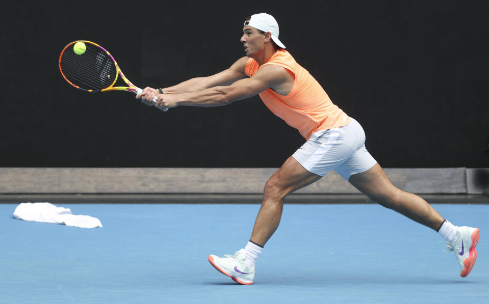 Spain's Rafael Nadal hits a backhand during practice session ahead of the Australian Open in Melbourne, Australia, Sunday, Feb. 7, 2021.(AP Photo/Hamish Blair)