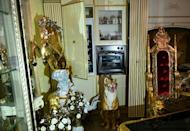The villas revealed the 'eccentric aesthetic taste' of a clan of particularly fierce loan sharks with a penchant for bling (AFP/Alberto PIZZOLI)
