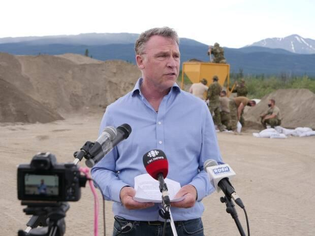 'We're quite confident now that we may have seen the water peak,' said Yukon Community Services Minister Richard Mostyn, seen here at Army Beach in early July. (Vincent Bonnay/Radio-Canada - image credit)